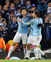 Manchester City's Sergio Aguero celebrates with team-mates Leroy Sane (left) David Silva after scoring the opening goal from the penalty spot<br /> <br /> Photographer Rich Linley/CameraSport<br /> <br /> UEFA Champions League Round of 16 Second Leg - Manchester City v FC Schalke 04 - Tuesday 12th March 2019 - The Etihad - Manchester<br />  <br /> World Copyright © 2018 CameraSport. All rights reserved. 43 Linden Ave. Countesthorpe. Leicester. England. LE8 5PG - Tel: +44 (0) 116 277 4147 - admin@camerasport.com - www.camerasport.com