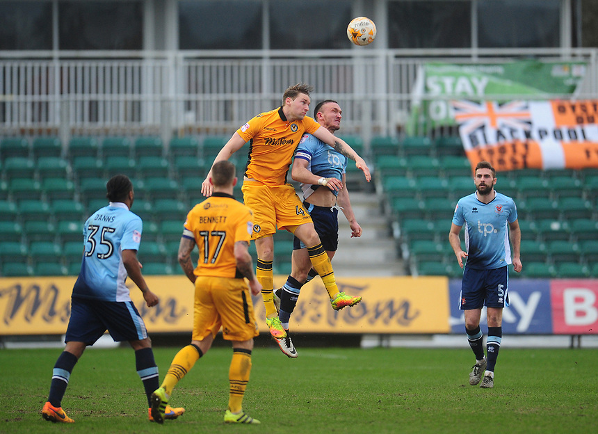 Newport County's Ryan Bird vies for possession with Blackpool's Tom Aldred<br /> <br /> Photographer Kevin Barnes/CameraSport<br /> <br /> The EFL Sky Bet League Two - Saturday 18th March 2017 - Newport County v Blackpool - Rodney Parade - Newport<br /> <br /> World Copyright &copy; 2017 CameraSport. All rights reserved. 43 Linden Ave. Countesthorpe. Leicester. England. LE8 5PG - Tel: +44 (0) 116 277 4147 - admin@camerasport.com - www.camerasport.com