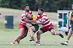 Josh Baverstock gets tackled by Seluini Molia and Salesitongi Savelio. Counties Manukau Premier Counties Power Club Rugby game between Karaka and Pukekohe, played at the Karaka Sports Park on Saturday March 10th 2018. Pukekohe won the game 31 - 27 after trailing 5 - 20 at halftime.<br /> Photo by Richard Spranger.
