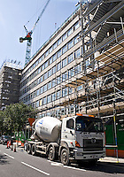 Concrete mixer lorry delivering concrete to a building site in central London