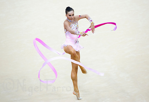 11 AUG 2012 - LONDON, GBR - Liubou Charkashyna (BLR) of Belarus performs her ribbon routine during the 2012 London Olympic Games Individual All-Around Rhythmic Gymnastics final at Wembley Arena in London, Great Britain (PHOTO (C) 2012 NIGEL FARROW)