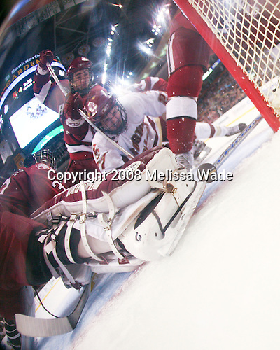 Kyle Richter (Harvard 33) and Brian McCafferty (Harvard 2) can't stop Orpik who watches as the puck begins to cross the line to make it 5-3 BC. The Boston College Eagles defeated the Harvard University Crimson 6-5 in overtime on Monday, February 11, 2008, to win the 2008 Beanpot at the TD Banknorth Garden in Boston, Massachusetts.