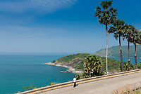 Tourist walking along the sea on Promthep Cape, Phuket, Thailand