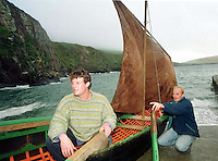 Lorcan Slattery, left,  and Paidi de Hora pictured with a Kerry curragh at  Dun Chaoin Pier in County Kerry.  The Kerrymen hope to make a curragh in New Zealand.<br />