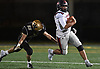 William Pickett #29, South Side quarterback, scrambles as Andrew Amato #52 of Wantagh closes in for the tackle during the Nassau County football Conference III semifinals at Shuart Stadium in Hempstead on Saturday, Nov. 10, 2018.