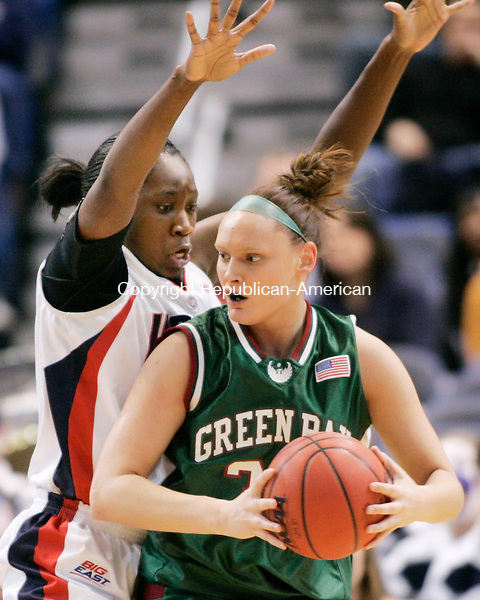 HARTFORD, CT. 20 March 2007-032007SV08--#31 Tina Charles of UConn triesto block #32 Nicole Soulis of Wisconsin Green Bay during the second round of NCAA action at the Civic Center in Hartford Tuesday.<br /> Steven Valenti Republican-American