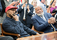 Kanye West, left, listens as he meets with United States President Donald J. Trump and Jim Brown, right, in the Oval Office of the White House in Washington, DC on Thursday, October 11, 2018.<br /> Credit: Ron Sachs / CNP /MediaPunch