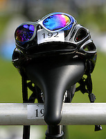 95 JUN 2005 - BALA, NORTH WALES, UK - A bike helmet and sunglasses rest on a rack in transition at the British Middle Distance Triathlon Championships. (PHOTO (C) NIGEL FARROW)
