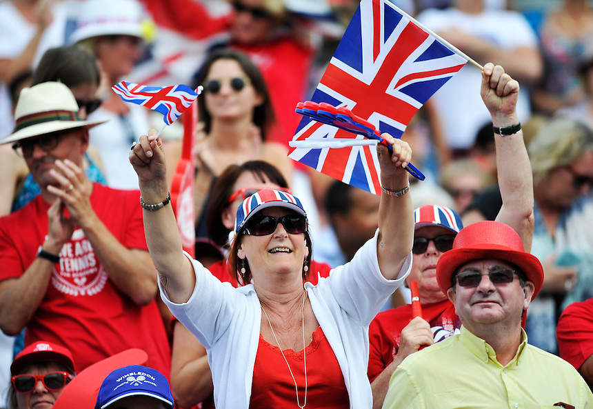 GB fans celebrate during the Andy Murray/Jamie Murray match against Jo-Wilfried Tsonga and Nicolas Mahut  - J Murray (GB) / A Murray (GB) def N Mahut (FRA) / J W Tsonga (FRA) 4-6, 6-3, 7-6, 6-1<br /> <br /> <br /> Photographer Ashley Western/CameraSport<br /> <br /> International Tennis - 2015 Davis Cup by BNP Paribas - World Group Quarterfinals - Great Britain v France - Day 2 - Saturday 18th July 2015 - Queens Club - London<br /> <br /> &copy; CameraSport - 43 Linden Ave. Countesthorpe. Leicester. England. LE8 5PG - Tel: +44 (0) 116 277 4147 - admin@camerasport.com - www.camerasport.com.