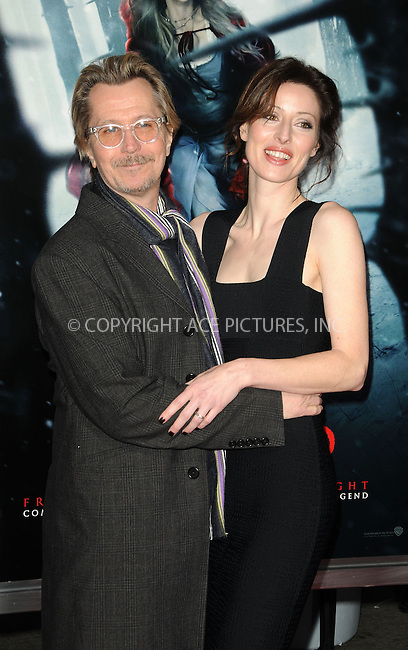 WWW.ACEPIXS.COM . . . . . ......March 7 2011, Los Angeles....Actor Gary Oldman and Alexandra Edenborough arriving at the premiere of Warner Bros. Pictures' 'Red Riding Hood' at Grauman's Chinese Theatre on March 7, 2011 in Hollywood, California.....Please byline: PETER WEST - ACEPIXS.COM....Ace Pictures, Inc:  ..(212) 243-8787 or (646) 679 0430..e-mail: picturedesk@acepixs.com..web: http://www.acepixs.com