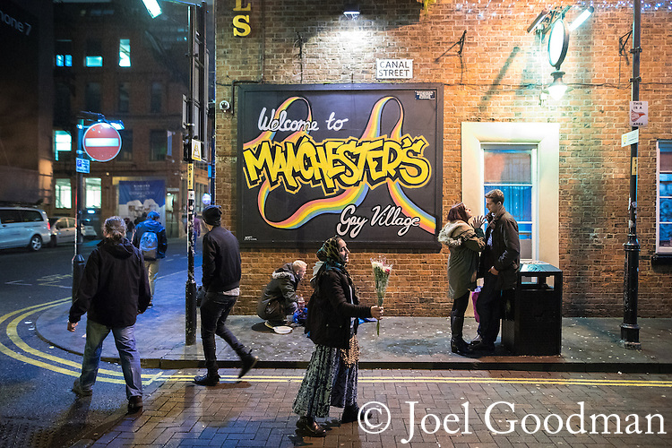 """© Joel Goodman - 07973 332324 . 16/12/2016 . Manchester , UK . People on Canal Street in Manchester's Gay Village . Revellers out in Manchester City Centre overnight during """" Mad Friday """" , named for being one of the busiest nights of the year for the emergency services in the UK . Photo credit : Joel Goodman"""