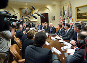 United States President Donald Trump makes remarks at a breakfast and listening session with key business leaders in the Roosevelt Room of the White House in Washington, DC on Monday, January 23, 2017.<br /> Credit: Ron Sachs / Pool via CNP