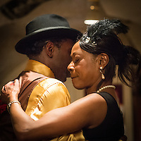 Jelly Germain and Sylvia Howard at a jazz concert by the Fantastic Harlem Drivers at the Petit Journal St Michel, Paris, Saturday 19th April 2014. The Fantastic Harlem Drivers consist of pianist Lou Lauprete, clarinetist Alain Marquet, double bass player Bernard Brimeur, and vocalists Sylvia Howard and Nicolle Rochelle, accompanied by tap-dancers Jelly Germain, his son Osiris Germain and Caroline Podetti. Lou Lauprete and Alain Marquet are regulars at Paris Boogie Speakeasy, the  private Parisian jazz club founded and run by Yves Riquet. Sylvia Howard sings with the Duke Ellington orchestra and the Black Label Swingtet, each led by saxophone player Christian Bonnet. Nicolle Rochelle is an internationally known singer, dancer, and actress, the star of Jerome Savary's 'Josephine' which ran for four years in France and Europe, in which Nicolle took the lead role as Josephine Baker. The evening was also attended by Yves Riquet (Sponsor and founder of Paris Boogie Speakeasy) and Jean-Paul Amouroux introduced as the finest player of Boogie-Woogie in Europe. The Fantastic Harlem Drivers were recently recorded for a new CD at Paris Boogie Speakeasy, 256 Rue Marcadet, Paris. Saturday 19th April 2014.
