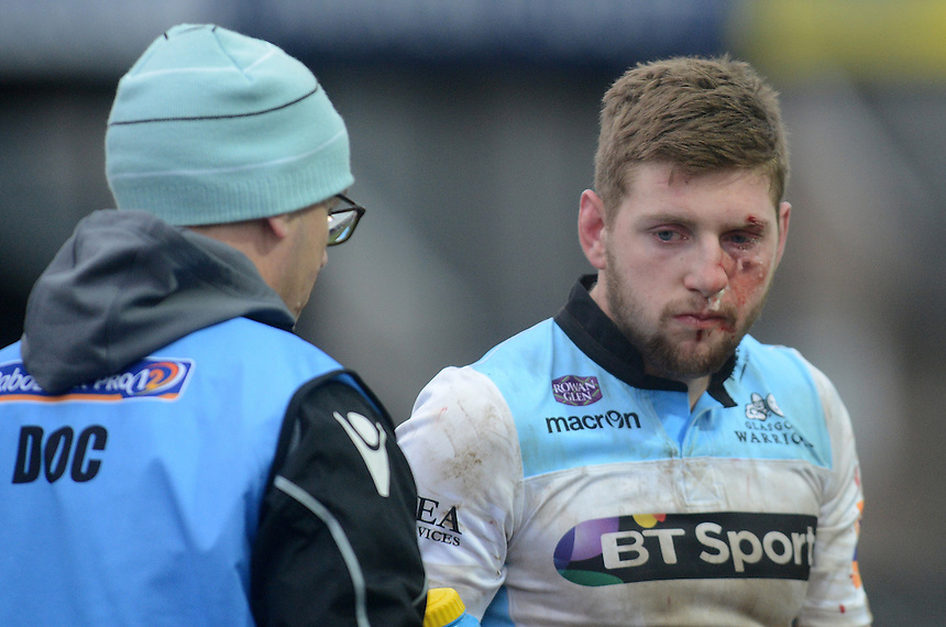 Glasgow Warrior's Finn Russell receives treatment for a cut to his face<br /> <br /> Photo by Ian Cook/CameraSport<br /> <br /> Rugby Union - RaboDirect PRO12 - Newport Gwent Dragons v Glasgow Warriors - Sunday 23rd February 2014 - Rodney Parade - Newport<br /> <br /> &copy; CameraSport - 43 Linden Ave. Countesthorpe. Leicester. England. LE8 5PG - Tel: +44 (0) 116 277 4147 - admin@camerasport.com - www.camerasport.com
