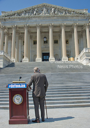 United States Senate Minority Leader Harry Reid (Democrat of Nevada) looks up the steps as he awaits the arrival of other Democratic members of the US House of Representatives and US Senate as they assemble on the East Steps of the US Capitol to call on Republican leadership in both legislative bodies to schedule votes on funding to combat the Zika Virus, to prohibit people on the federal &quot;no fly&quot; list from purchasing guns, and to conduct confirmation hearings and schedule a vote on the confirmation of Judge Merrick Garland as Associate Justice of the US Supreme Court in Washington, DC on Thursday, September 8, 2016.<br /> Credit: Ron Sachs / CNP