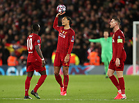 11th March 2020; Anfield, Liverpool, Merseyside, England; UEFA Champions League, Liverpool versus Atletico Madrid;  Virgil van Dijk of Liverpool holds the ball above his head