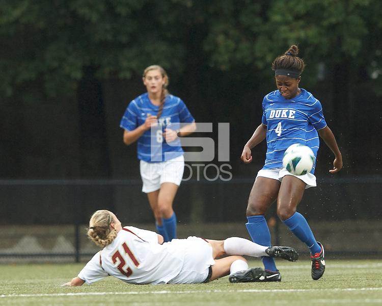 Boston College midfielder Kate McCarthy (21) slide tackle disrupts Duke University defender Natasha Anasi (4).Boston College (white) defeated Duke University (blue/white), 4-1, at Newton Campus Field, on October 6, 2013.
