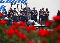 Jun 6, 2015; Englishtown, NJ, USA; Crew members surround the dragster of NHRA top fuel driver Antron Brown during qualifying for the Summernationals at Old Bridge Township Raceway Park. Mandatory Credit: Mark J. Rebilas-