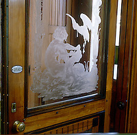 A mysterious figure in combat with a dragon can be found etched in glass on the door of an historic pharmacy in Stockholm