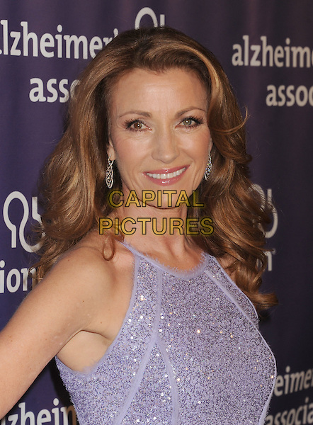 "Jane Seymour.arriving at the 20th Anniversary Alzheimer's Association ""A Night At Sardi's"" at The Beverly Hilton Hotel in Beverly Hills, California, USA, .March 21st, 2012..portrait headshot smiling purple sparkly .CAP/ROT/TM.©TM/Roth Stock/Capital Pictures"