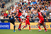 Brian Carroll (7) of the Philadelphia Union and Danny Koevermans (14) of Toronto FC look to play the ball. The Philadelphia Union defeated Toronto FC 3-0 during a Major League Soccer (MLS) match at PPL Park in Chester, PA, on July 8, 2012.