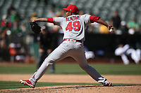 OAKLAND, CA - SEPTEMBER 20:  Miguel Almonte #49 of the Los Angeles Angels of Anaheim pitches against the Oakland Athletics during the game at the Oakland Coliseum on Thursday, September 20, 2018 in Oakland, California. (Photo by Brad Mangin)