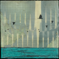 Antique map with encaustic photography of birds flying over the ocean.