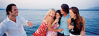 A group of models make a sunset toast on a Sea Ray yacht for a shoot in Ixtapa Zihuatanejo, Mexico 5-19-05