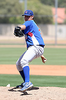 Ben Wells of the Chicago Cubs pitches in an extended spring training game against the Oakland Athletics at the Cubs complex on April 15, 2011 in Mesa, Arizona. .Photo by:  Bill Mitchell/Four Seam Images.