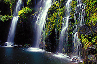 Several waterfalls feed into a Hana, Maui pool.