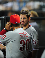 Apr. 25, 2011; Phoenix, AZ, USA; Philadelphia Phillies pitcher Cliff Lee (right) talks to pitching coach Rich Dubee against the Arizona Diamondbacks at Chase Field. Mandatory Credit: Mark J. Rebilas-