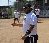 NWA Democrat-Gazette/ANDY SHUPE<br /> Dennis Donahue Jr., a maintenance worker for Tyson Foods, cheers Saturday, Aug. 15, 2015, as his team scores at the end of the game during the 33rd annual Tyson Foods Corporate Softball Tournament at the Randal Tyson Sports Complex in Springdale.