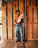 PANAMA, Bocas del Toro, portrait of a young fisherman holding a large Red Snapper, Central America