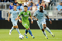 Birahim Diop (20) midfielder Sporting KC, Fredy Montero (17)  forward Seattle Sounders in action....... Sporting Kansas City were defeated 1-2 by Seattle Sounders at LIVESTRONG Sporting Park, Kansas City, Kansas.