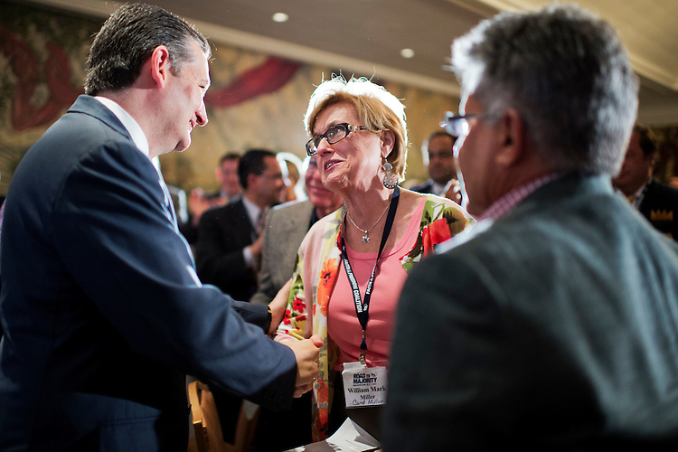 UNITED STATES - JUNE 18: Sen. Ted Cruz, R-Texas, greets Carol Miller of Sulpher Springs, Texas, at the Faith & Freedom Coalition's Road to Majority conference which featured speeches by conservative politicians at the Omni Shoreham Hotel, June 18, 2015. (Photo By Tom Williams/CQ Roll Call)