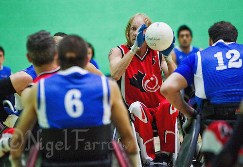 15 AUG 2011 - LEEDS, GBR - Canada's Garett Hickling prepares to pass during the wheelchair rugby exhibition match against Great Britain (PHOTO (C) NIGEL FARROW)