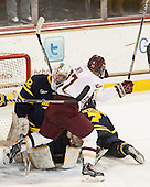 Rasmus Tirronen (Merrimack - 32), Quinn Smith (BC - 27) - The Boston College Eagles defeated the visiting Merrimack College Warriors 2-1 on Wednesday, January 21, 2015, at Kelley Rink in Conte Forum in Chestnut Hill, Massachusetts.
