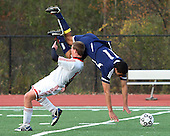 Tariq Akeel (11), Detroit Country Day, gets upended by Alex Masserant, Grosse Ile, during regional soccer action at Country Day Saturday, Oct. 29, 2011.