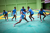 A raider touches (to make a point) one of the defendant team-members during the kabbadi training sessions as part of the training at a month long camp for the Indian national Kabbadi team in Sport Authority of India Sports Complex in Bisankhedi, outskirts of Bhopal, Madhya Pradesh, India.