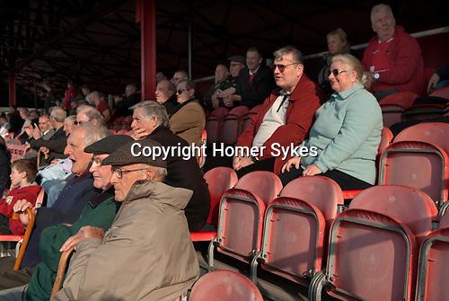 "The Fleet football team supporters at the ""home end"". Ebbsfleet v Tunbridge. Ebbsfleet Valley Kent UK.   2014."