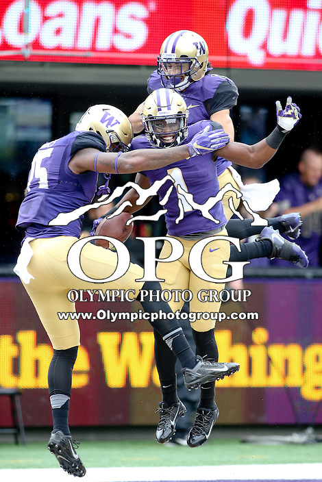 03 September 2016:  Washington wide receiver #1 John Ross celebrates with #15 Darrell Daniels and #8 Dante Pettis after hauling in a 50-yard pass from Jake Browning in the first quarter against Rutgers.  Washington defeated Rutgers 48-13 at the University of Washington in Seattle, WA.