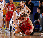 BROOKINGS, SD - JANUARY 17:  Kerri Young #11 from South Dakota State battles for the loose ball with Bridget Arens #22 from the University of South Dakota in the first half of their game Sunday afternoon at Frost Arena in Brookings, S.D. (Photo by Dave Eggen/Inertia)