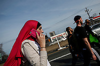 A woman walks during the March4justice in North Brunswick, New Jersey 04.13.2015. The Action it's a nine day march from NYC to the U.S. Capitol in Washington DC. Kena Betancur/VIEWpress.