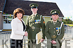 Defence Forces members Sergeant Chris Hoare, Killorglin originally and Gunner James Power, Waterford, are welcomed by Principal Annette Dineen of Listellick N.S when they presents the tricolour and Proclamation to the school on Monday