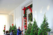 """Workers put the finishing touches on the 2017 White House Christmas decorations, with the theme """"Time-Honored Traditions,"""" which were personally selected by first lady Melania Trump, are previewed for the press in Washington, DC on Monday, November 27, 2017.  These decorations are over the door of the East Entrance where guests arrive for events at the White House.<br /> Credit: Ron Sachs / CNP"""