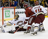 Cory Schneider (Boston College - Marblehead, MA) makes a save as Alex Meintel (Harvard University - Yarmouth, ME) heads in with Matt Greene (Boston College - Plymouth, MA) on his back. The Boston College Eagles defeated the Harvard University Crimson 3-1 in the first round of the 2007 Beanpot Tournament on Monday, February 5, 2007, at the TD Banknorth Garden in Boston, Massachusetts.  The first Beanpot Tournament was played in December 1952 with the scheduling moved to the first two Mondays of February in its sixth year.  The tournament is played between Boston College, Boston University, Harvard University and Northeastern University with the first round matchups alternating each year.