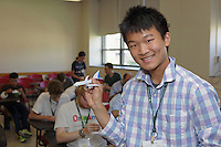 OrigamiUSA 2016 Convention at St. John's University, Queens, New York, USA. Airliner class taught by Andrew Mao, Maryland. This is Mao's own design. He is 16 years old.