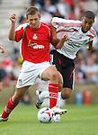 Wrexham's Mark Jones and Liverpool's Lee Peltier