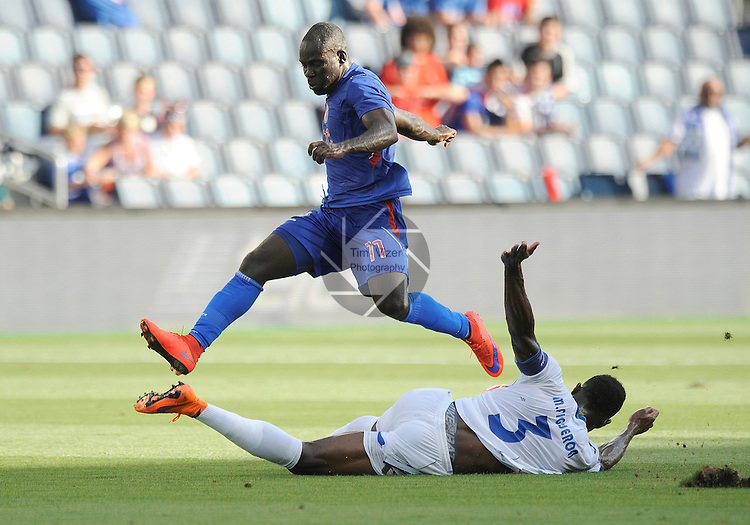 Haiti's Pascal Millien (11) leaps over Honduras Maynor Figueroa (3) in the first half. Haiti defeated Honduras 1-0 in a Group A game during a Gold Cup game at Sporting Park in Kansas City, Kansas on Monday July 13, 2015.
