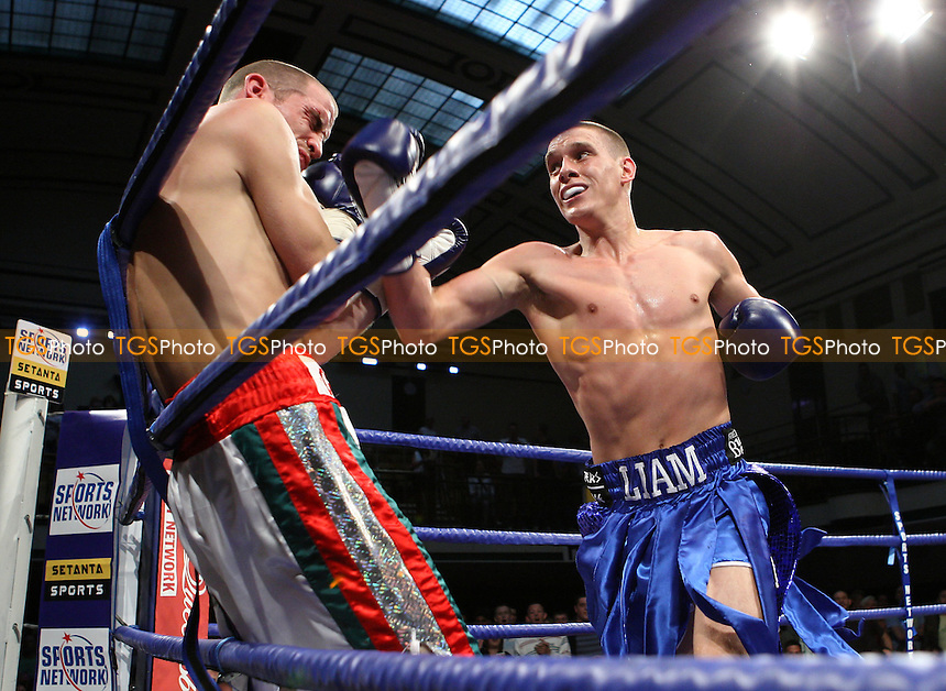 Liam Walsh (Cromer, blue shorts) defeats Johnny Greaves (East Ham, white/red shorts) in a Lightweight contest at York Hall, Bethnal Green, promoted by Frank Warren, Sports Network - 14/06/08 - MANDATORY CREDIT: Gavin Ellis/TGSPHOTO. Self-Billing applies where appropriate. NO UNPAID USE. Tel: 0845 094 6026